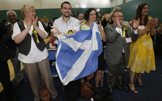 Scottish National Party supporters celebrate after its announced Mason has won the Glasgow east by-election at the Tollcross leisure centre