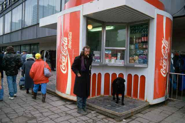 Pedestrian and Dog by Coca-Cola Stand in Moscow